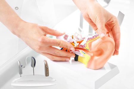 Photo pour Otolaryngologist, selection of hearing aid. - image libre de droit