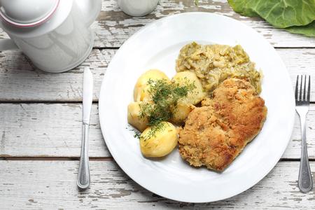Photo pour Traditional  Polish cuisine, pork chop with potatoes and fried cabbage. - image libre de droit