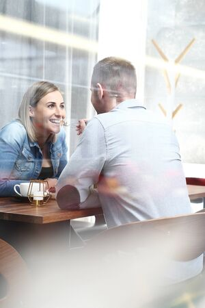 Photo for Coffee conversation. Woman and man during a date in a cafe. Real life. - Royalty Free Image