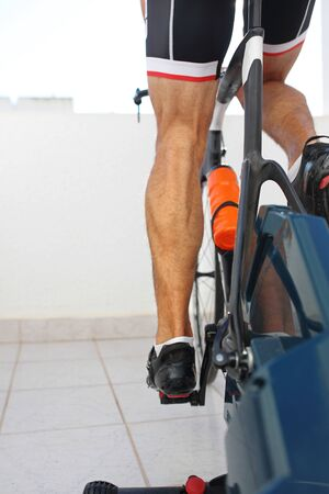 Photo pour Riding an exercise bike. Sports training on a stationary exercise bike. - image libre de droit