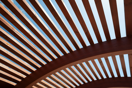 Foto de Modern architectural construction of wooden slats with half-round, openwork design - Imagen libre de derechos