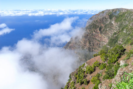 El Hierro - Passat clouds at the rock face of the El Golfo Valley