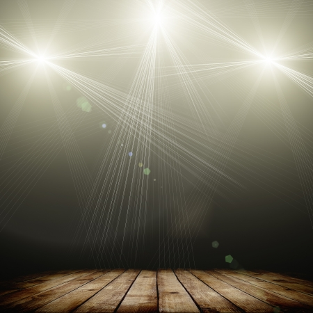 Photo for ilustration of concert spot lighting over dark background and wood floor - Royalty Free Image