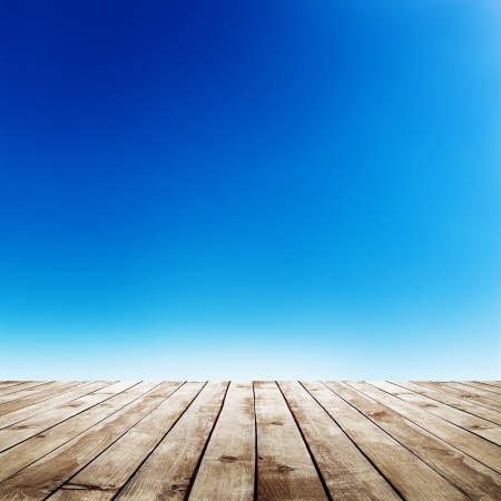 blue sky with clouds and wood planks floor