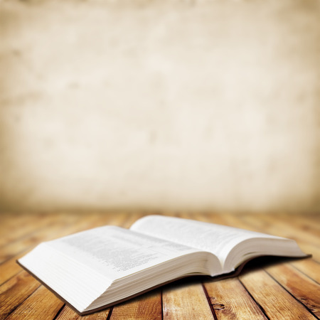 Open Book on wood background