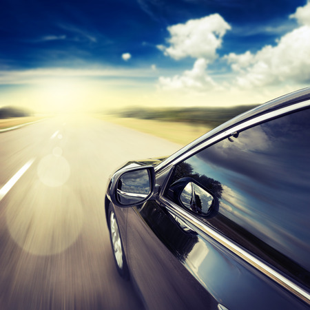 Foto de Blurred road and car, speed motion background - Imagen libre de derechos