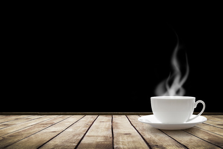 Photo pour Cup with hot drink on table over black background - image libre de droit