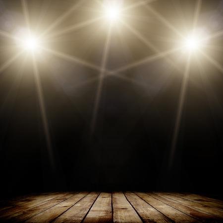Photo pour ilustration of concert spot lighting over dark background and wood floor - image libre de droit