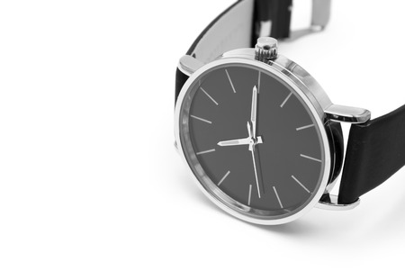 Classic wrist watch over white background.