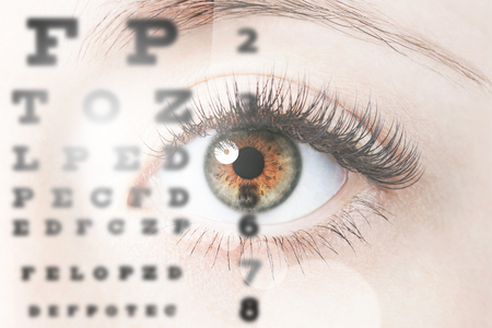 Foto de Close up image of human eye through eye chart - Imagen libre de derechos