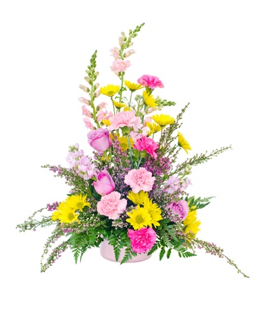 Colorful fresh flower arrangement centerpiece with daisies, carnations, roses and snapdragons isolated on white