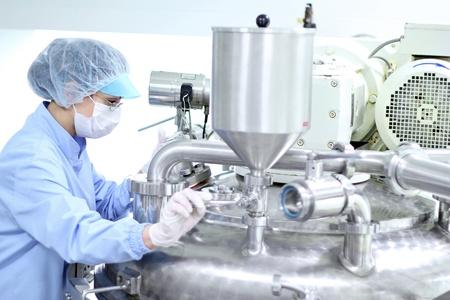 Preparing machine for work in pharmaceutical factory.