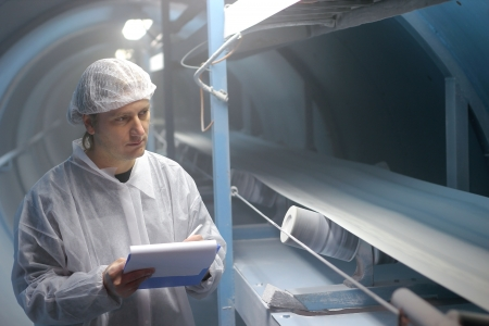 Quality inspector monitoring the process of crystal sugar production,