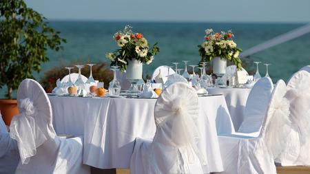 Foto de Outdoor Table Setting at Wedding Reception by the Sea - Imagen libre de derechos