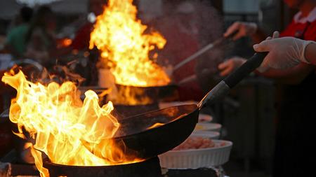 Photo pour Chef Cooking in Outdoor Kitchen - image libre de droit