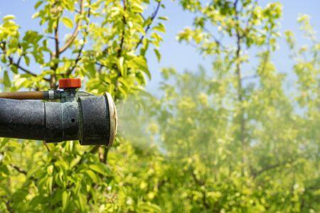 Foto für Atomizing Spray Nozzle Spraying Orchard Close Up Shot - Lizenzfreies Bild