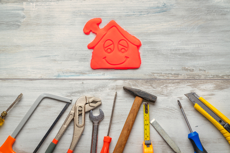 Photo for Set of work tool on rustic wooden background with icon of house in space, industry engineer tool concept.still-life. - Royalty Free Image