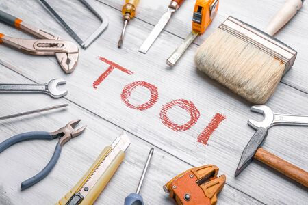 Photo for Set of work tools on rustic wooden background with written - Royalty Free Image