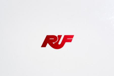 TURIN, ITALY - JUNE 9, 2016: Red Ruf logo on a white Porsche body