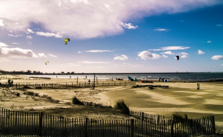 Beach with kite surfers