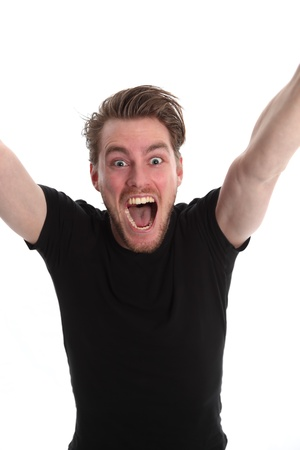 Yeeeaah!! Man screaming with his arms up, wearing a black t-shirt. White background.