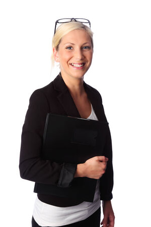 Cute and attractive businesswoman wearing a black suit and glasses, holding a document folder