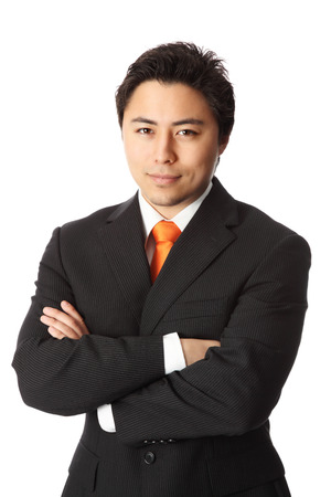 Young attractive businessman wearing a suit and orange tie. White background.