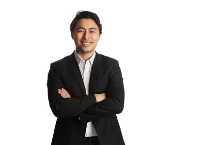 Photo pour An attractive businessman wearing a black blazer with a white shirt, standing against a white background looking at camera. Smile on his face. - image libre de droit
