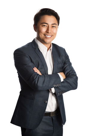 Photo pour A well dressed businessman in a blue suit and white shirt, standing against a white background smiling towards camera. - image libre de droit