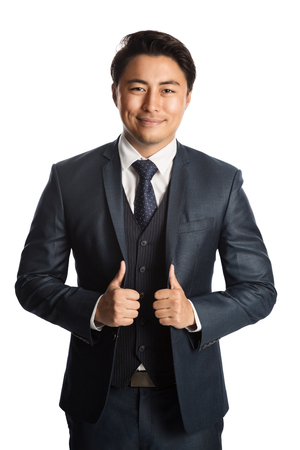 Photo for Handsome and well dressed businessman in a suit, tie and vest, standing against a white background smiling towards camera. - Royalty Free Image
