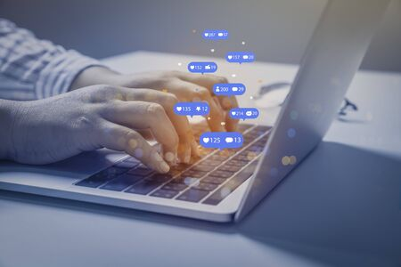 Photo pour Person using a social media marketing concept on computer tablet with notification icons of like, chat, message and comment above tablet screen. - image libre de droit