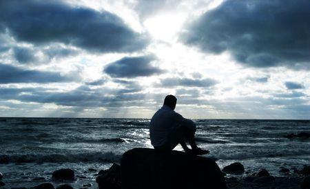 Alone man thinking at the beach