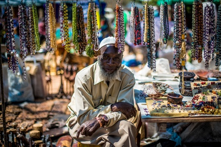 A local jewelry maker and his wears, at a market in Zambia