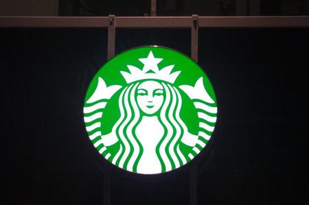 Gdansk, Poland - December 9, 2017: Starbucks logo coffee company at night time.