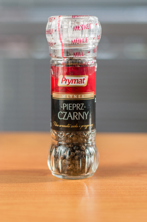 Pruszcz Gdanski, Poland - January 25, 2018: Prymat pepper in pepper mill on wooden table.