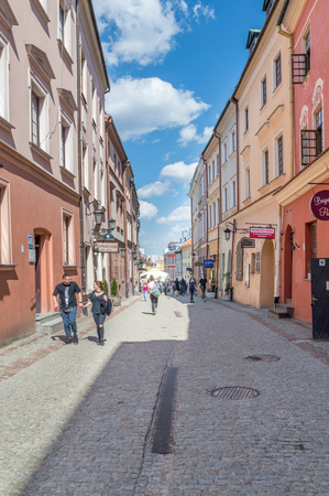 Lublin, Poland - April 14, 2018: Grodzka street with unidentified people in the old town of Lublin.