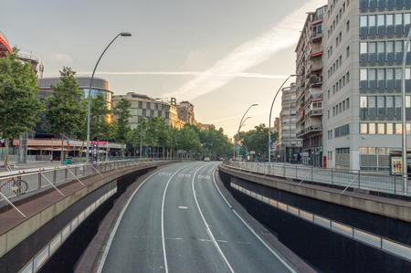 Barcelona, Spain - June 9, 2018: Great Way of the Catalan Courts (Gran Via de les Corts Catalanes) at sunrise.