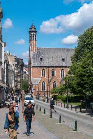 Brussels, Belgium - June 6, 2019: Rue de la Madeleine street with Maria Magdalenakerk church.