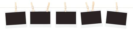 Five pieces of blank instant film held on a string with clothespins isolated on white.