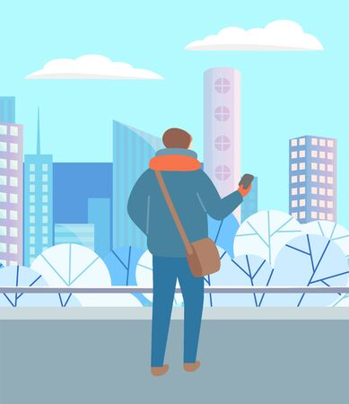 Illustration for Man walking through urban winter park alone. Person in warm clothes, hat and scarf standing with telephone in hand. Beautiful snowy landscape of city on background. Vector illustration in flat style - Royalty Free Image