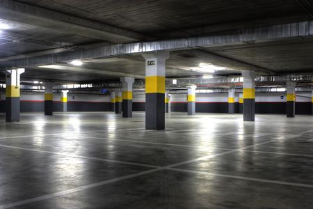 A Big Empty yellow Underground Parking Garage
