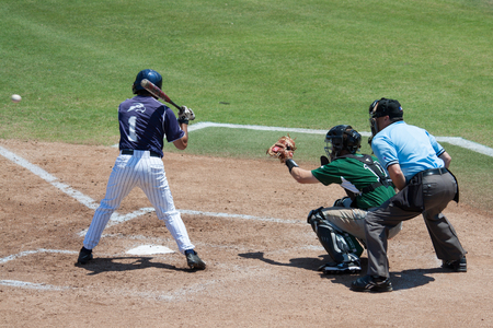 JACKSONVILLE, FL - APRIL 26, 2014: A batter from the University of North Florida takes a pitch during a baseball game against Stetson Universtiy.のeditorial素材