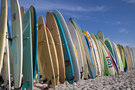 JACKSONVILLE BEACH, FL. USA - JUNE 6, 2015: Surfboards are staged for the Ocean Paddle part of the Never Quit Trident event which involves a 5k Run, 500M Ocean Swim and 1.5k Ocean Paddle.