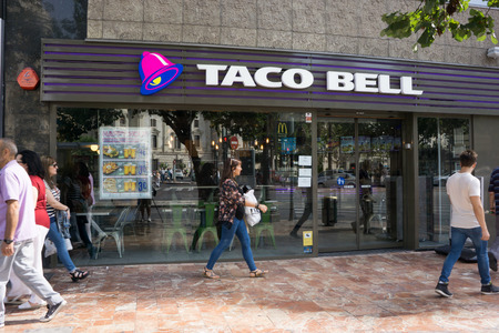 VALENCIA, SPAIN - SEPTEMBER 26, 2015: A Taco Bell fast-food restaurant in downtown Valencia. Taco Bell serves more than 2 billion customers each year in more than 5,800 restaurants.