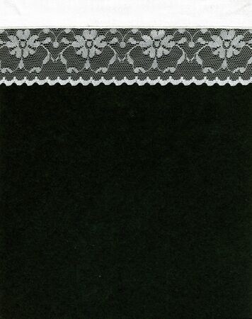 Image of lace border on black background