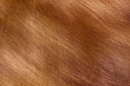 Background of brushed copper in full-frame.  Lovely textures and detail.