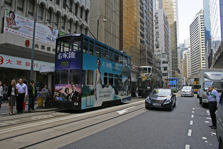 Hong Kong, China - April 9, 2010 - 'Ding Ding' Tram travelling the streets of Central