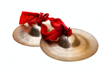 Chinese tradition percussion instrument - China small cymbals isolated on white,  usually it used  with the gong and  the drum together forms the Chinese percussion instrument team .