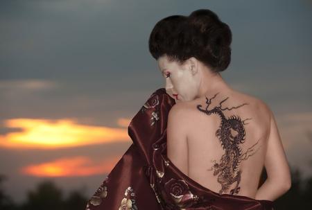 Geisha in vineyard