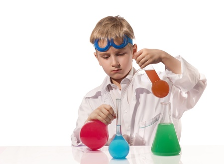 Boy in white overall with multicolored chemical flasks